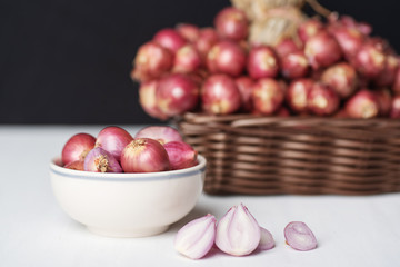 Red shallot onion in a bowl and basket, herb and spice, food ingredient
