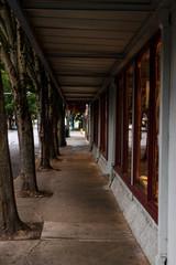 Empty retail storefront covered sidewalk