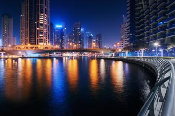 Beautiful view to Dubai Marina, UAE. Long exposure time lapse effect at night