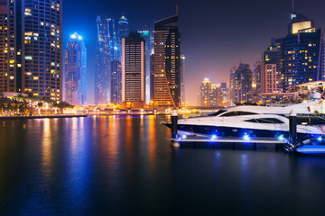 Beautiful view to Dubai Marina, UAE. City skyline. Long exposure time lapse effect at night
