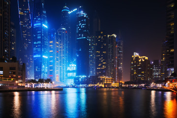 Beautiful view to Dubai Marina, UAE. Long exposure time lapse effect at night