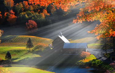 Old barn in Vermont rural side surrounded by fall foliage Wall mural