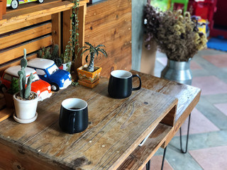 Best time to relax,two Black coffee cup on the wooden table in the morning, Coffee time with special one,Coffee lover.vintage style