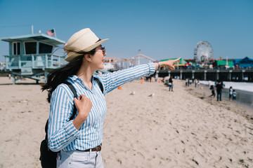a pretty female tourist standing on the beach