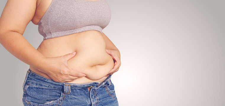 Fat woman touching her stomach