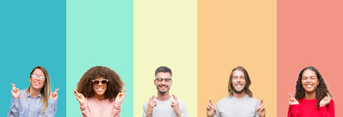 Collage of group of young people over colorful vintage isolated background smiling crossing fingers with hope and eyes closed. Luck and superstitious concept.