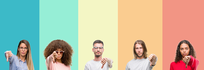 Collage of group of young people over colorful vintage isolated background looking unhappy and angry showing rejection and negative with thumbs down gesture. Bad expression.