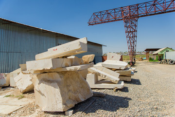 Huge travertine blocks. Untreated travertine in production. Rough rock texture