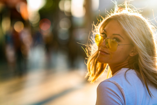 Blond girl on white T shirt walking Hollywood Blvd on sunset