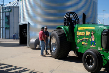 Bill Myer and Larry Harrin inspect a John Deere tractor at the 2018 Farm Progress Show in Boone Iowa