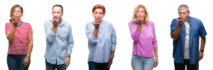 Collage of group of middle age and senior people over isolated background looking at the camera blowing a kiss with hand on air being lovely and sexy. Love expression.