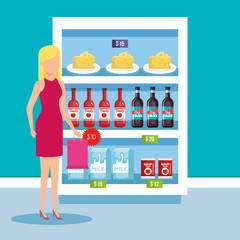 woman in supermarket refrigerator with products