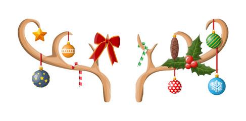 Fototapeta Reindeer antler with balls, bow, holly.