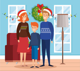 parents and son with december clothes in livingroom