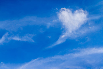 Perfect of real heart shaped from white softy cloud shown on cloudy blue sky. Background for love picture or business target or meteorology or inspiration concept