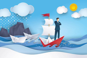 Businessman on Red and white sailing boat in the ocean