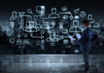 Businessman watching thin line social network icons interface