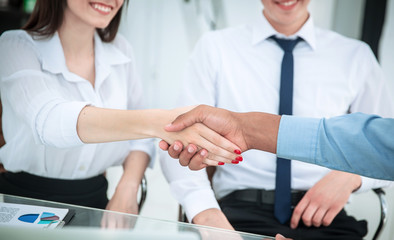 handshake between a business woman and investor