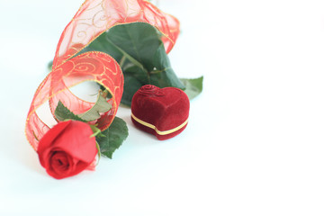 red rose and box with ring on white background.photo with copy s