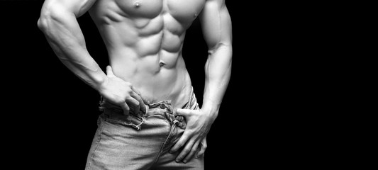Muscular and sexy torso of young man with perfect abs. Black and white photo