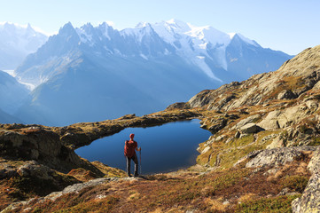 Fotomurales - Hiker looking at Lac des Cheserys on the famour Tour du Mont Blanc near Chamonix, France.