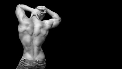 Isolated black and white muscle man. Back view