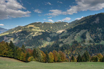 Wall Mural - Swiss mountain landscape with peaks and valleys in autumn colors near Klosters