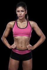 Sexy muscular woman in front of black background