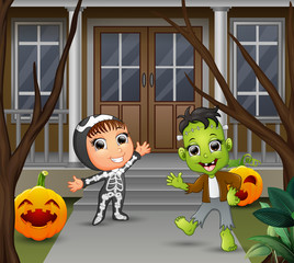 Cartoon of frankenstein and skeleton standing in front of the house