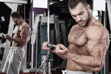 Young bodybuilder exercising in gym