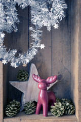 Christmas decoration deer figure and star in a wooden box background