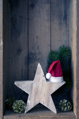 Christmas decoration Santa Clause hat on a star in a wooden box background