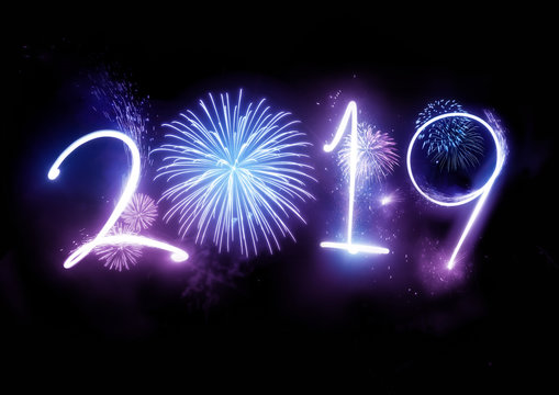 The year 2019 displayed with fireworks and strobes. New year celebration concept.