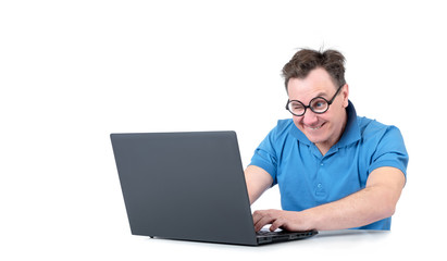 Man with glasses working on a laptop at the table, isolated on white background