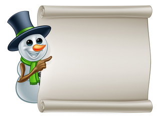 A snowman Christmas cartoon character pointing at a scroll banner sign