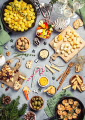 Christmas dinner party table, holiday vegeterian food concept background, top view, flat lay