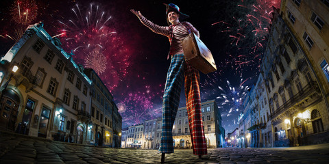 Night street circus performance whit clown. Festival city background. fireworks and Celebration atmosphere. Fototapete