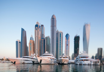 Skyline of Dubai marina from boat at sunset, shoot with tilt and shift lense