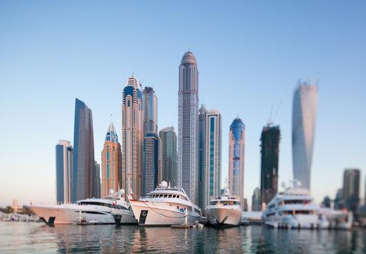 Skyline of Dubai marina from boat at sunset, shoot with tilt and shift lense