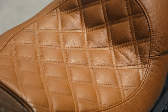 Leather motorcycle seat. Motorcycle with vintage, leather seat. Close-up seat of bike. Traveling concept