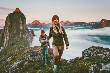 Couple travelers holding hands hiking together in Norway travel healthy lifestyle concept active vacations outdoor Segla mountain sunset landscape Wall mural