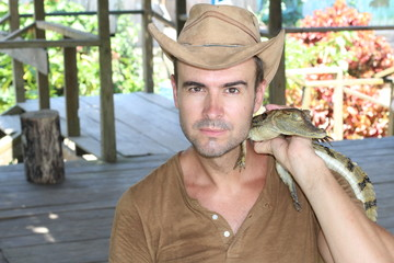 Man holding baby reptile with copy space