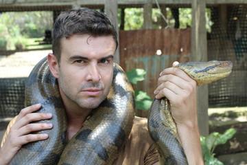 Brave man fighting a gigantic snake