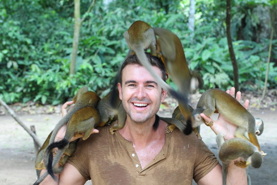 Man training a group of monkeys