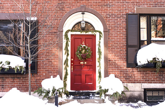 USA, Boston - January 2018 - House with christmas wreath on front door in Beacon Hill Area