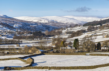 The barns at Gunnerside in Swaledale on a bright, snowy winter's day