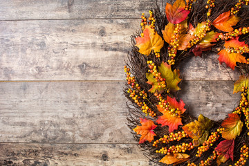 Autumn wreath on wooden background. Thanksgiving concept. Copyspace
