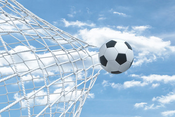 3d rendering of a football ball flying away from inside the gate net and tearing it.