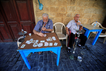 Elderly men smoke hookah in Sidon