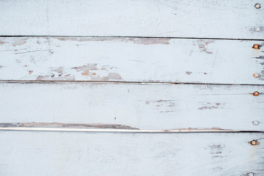 A background of stylish white nailing boards painted white, but already aged and out of color